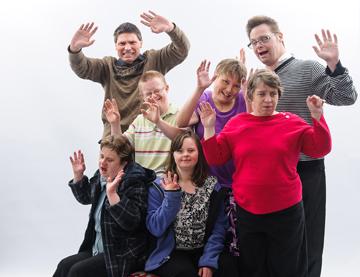 group of people waving