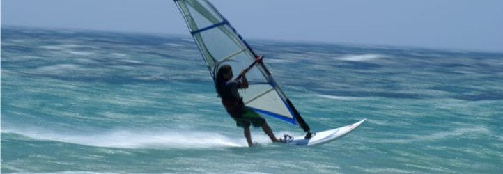 a wind surfer riding the waves
