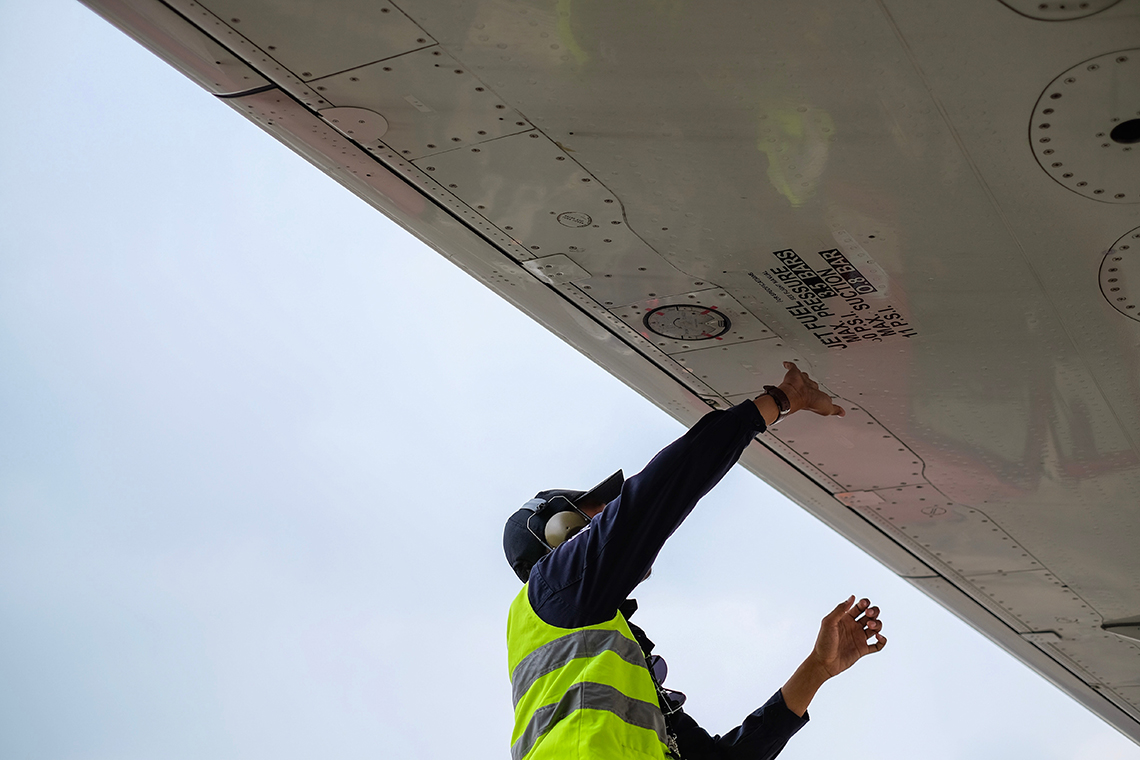 man maintaining an aeroplane