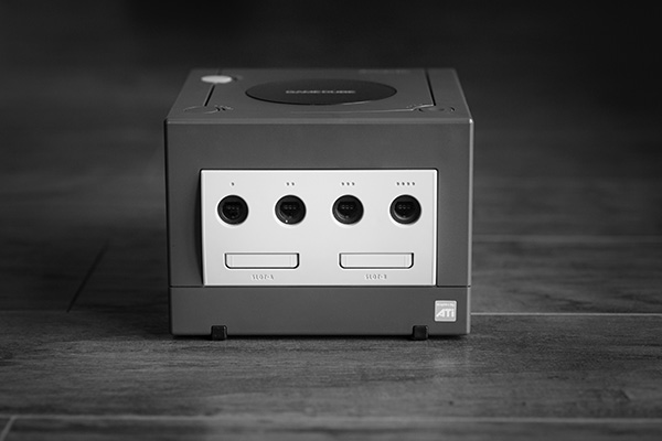 A black and white photo of box-shaped device on a wooden floor - used to illustrate a point about useless boxes taking up space