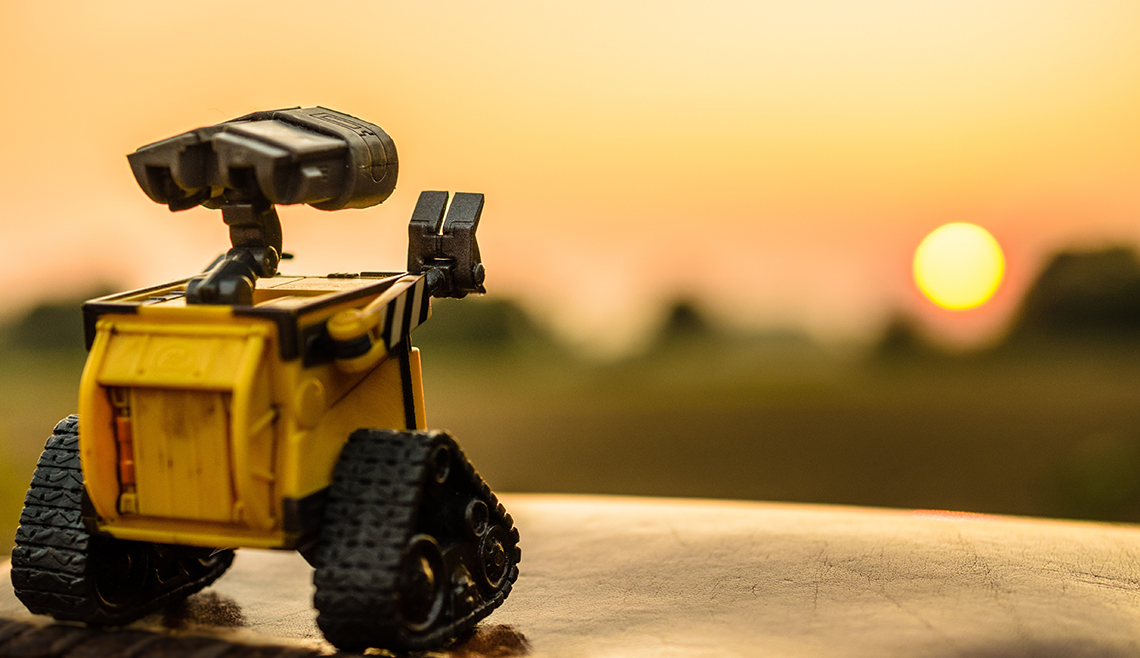 walle toy robot looking out to the sun