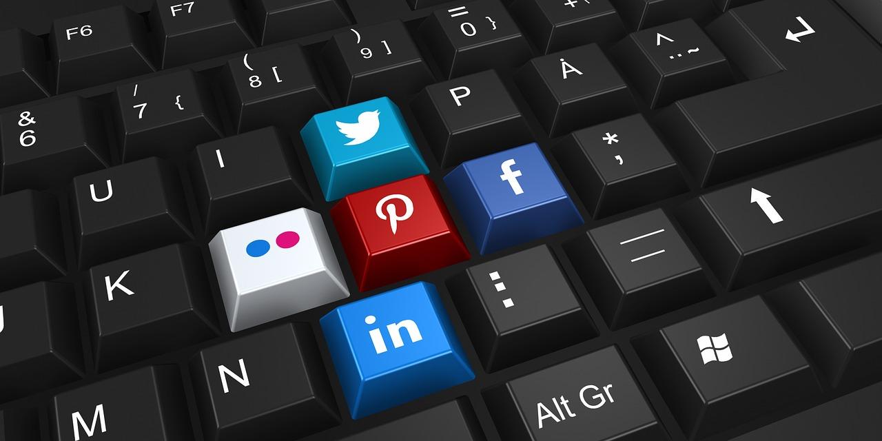 social media buttons on black keyboard