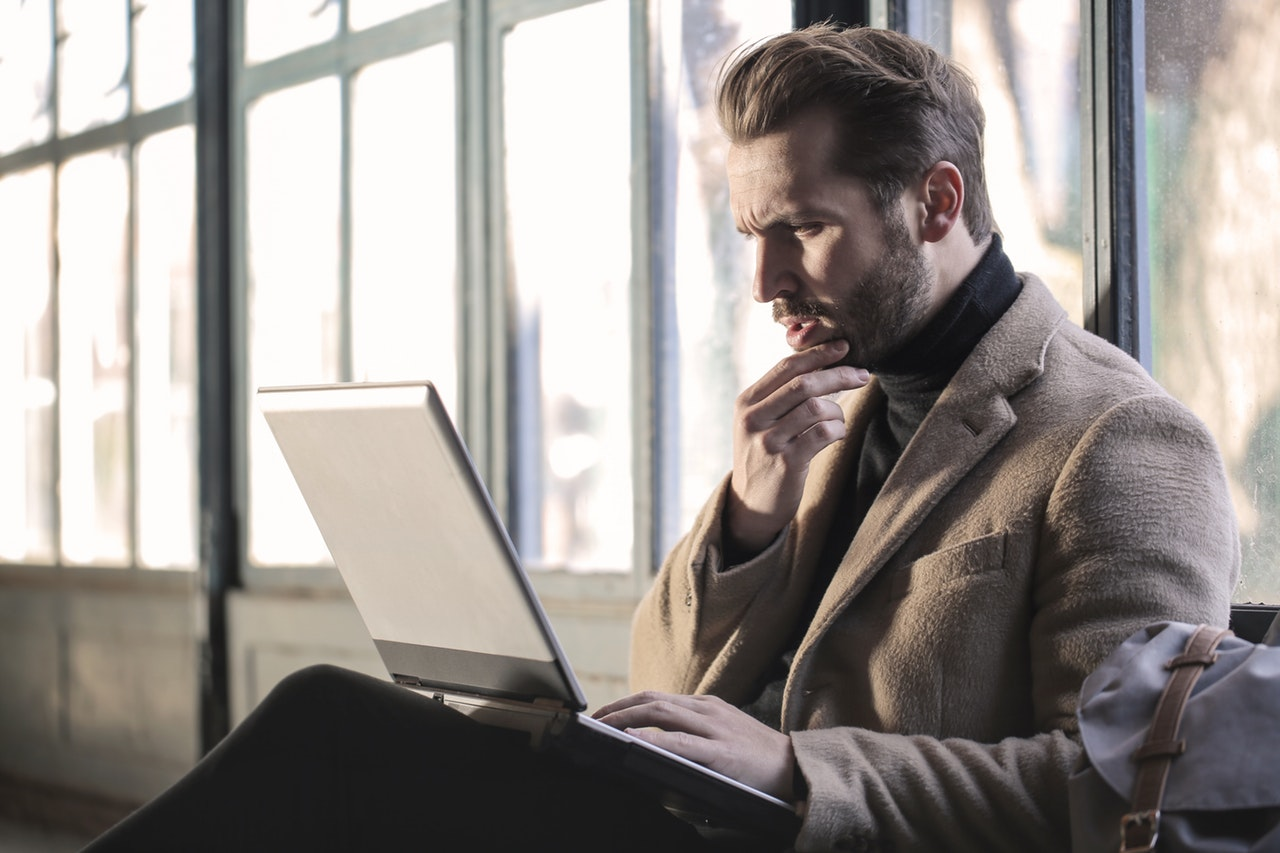confused man looking at a bad web design