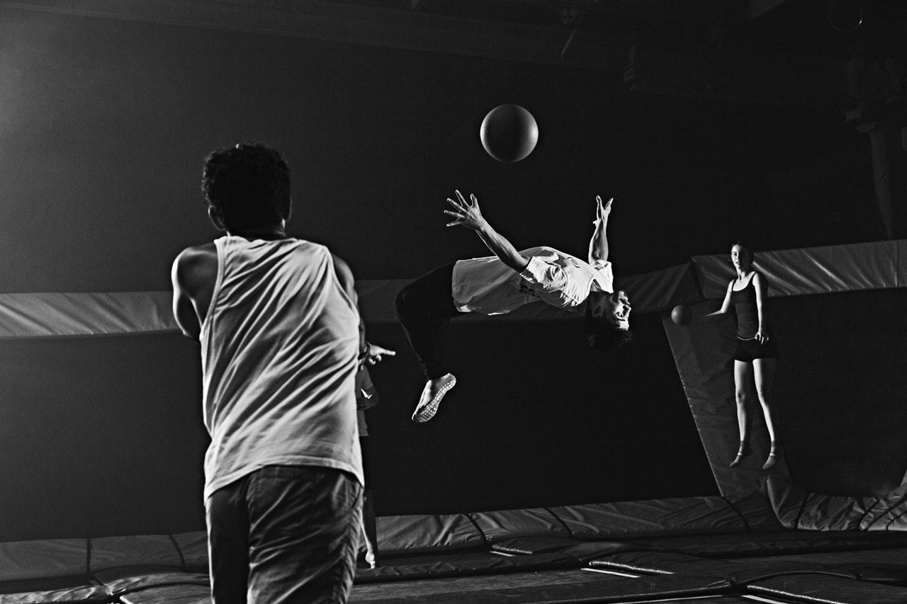 boy dodging a ball in a dodgeball game